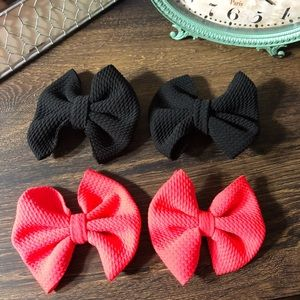 Other - 2 pairs of neon pink and black bows.